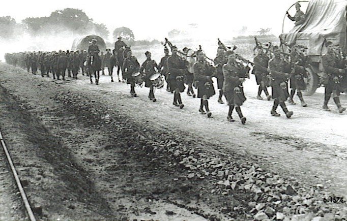 The Pipes and Drums of the 19th Battalion leading it on the march to Hill 70, August 1917.
